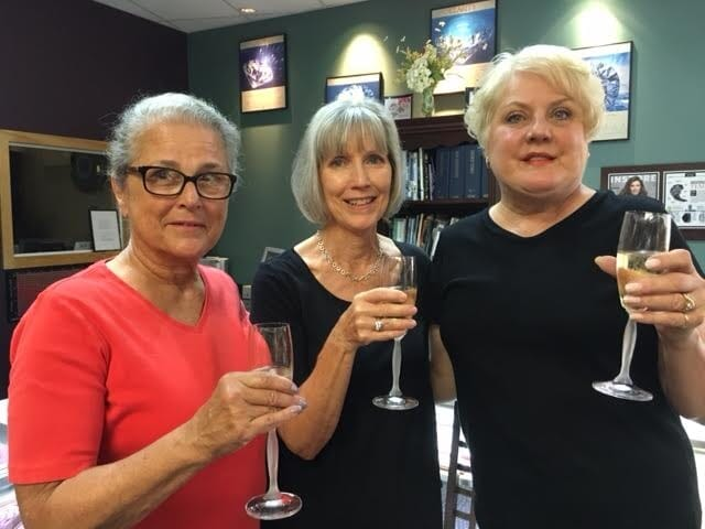 3 friends celebrating a buy it yourself bling!